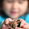 Kids will not learn how to wisely manage money on their own, we must be willing to teach them. (Image: ##http://www.photoxpress.com/stock-photos/sun/bank/box/659832##jeancliclac##)